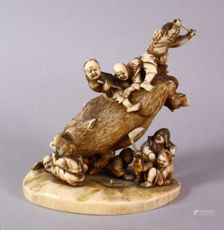 A JAPANESE MEIJI PERIOD CARVED IVORY OKIMONO GROUP- depicting a boar being attacked by numerous