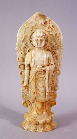 A 19TH / 20TH CENTURY CHINESE CARVED WHITE JADE / SOAPSTONE FIGURE OF A DEITY / BUDDHA, stood upon a