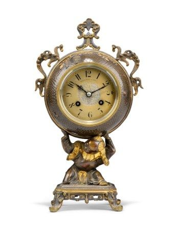 A FRENCH 'JAPONISME' PATINATED-BRONZE FIGURAL TABLE CLOCK THE MOVEMENT BY JAPY FRERES, RETAILED BY MANOAH RHODES & SON, THIRD QUARTER 19TH CENTURY