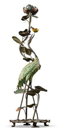 A COLD-PAINTED METAL TORCHERE MODELLED AS A CRANE 20TH CENTURY