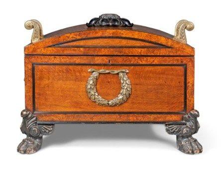 A REGENCY BRASS-MOUNTED BROWN OAK, OAK AND EBONISED OAK LARGE CELLARET ATTRIBUTED TO GEORGE BULLOCK, CIRCA 1815
