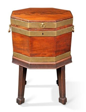A GEORGE III BRASS-MOUNTED MAHOGANY WINE-COOLER ON STAND CIRCA 1760
