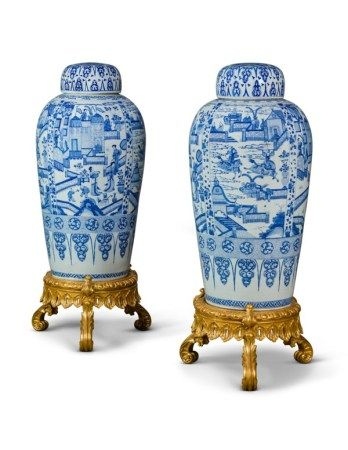 A PAIR OF CHINESE EXPORT BLUE AND WHITE PORCELAIN 'SOLDIER' VASES AND COVERS, ON GILTWOOD STANDS  KANGXI PERIOD (1662-1722)