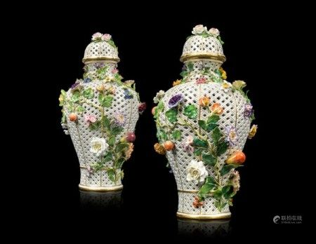 A PAIR OF LARGE MEISSEN PORCELAIN FLOWER-ENCRUSTED PIERCED VASES AND COVERS MID-19TH CENTURY, BLUE CROSSED SWORDS MARK