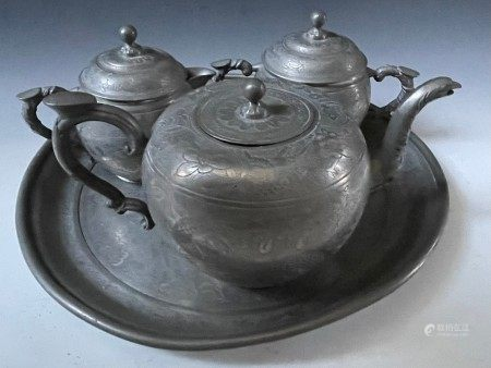 A Group of Three Copper Chinese Teapots and a Tray
