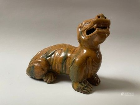 A Chinese Glazed Pottery Horned Beast Foo Dog Sculpture