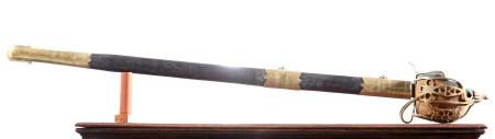 A HEAVY BRASS SCOTTISH BASKET HILT BROADSWORD
