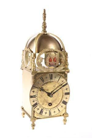 A BRASS FRAMED LANTERN CLOCK