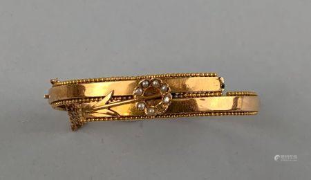 Bracelet articulé en or jaune 750 millièmes à décor d'une flèche traversant une couronne sertie