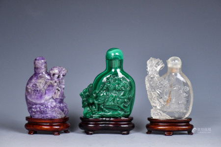 Three Chinese Carved Hardstone Snuff Bottles