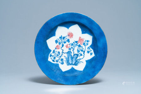 A Chinese blue, white and copper red powder blue-ground charger, Kangxi