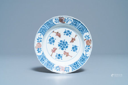 A Chinese blue, white and copper red 'fish' plate, Chenghua mark, Kangxi
