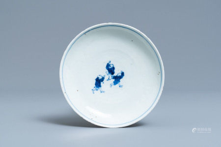 A Chinese blue and white ko-sometsuke plate with three playing boys for the Japanese market, Transitional period