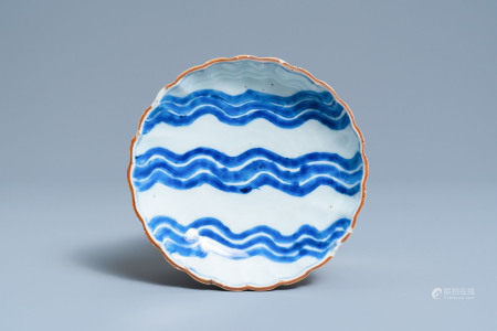 A Chinese blue and white ko-sometsuke 'wave' plate for the Japanese market, Chenghua mark, Tianqi