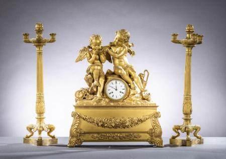 Three-piece Charles X clock set in gilt bronze 'putti' (67cm) (63x51x18cm)