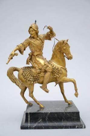 A gilt bronze sculpture on a marble base 'Oriental horseman' (h 43 cm)
