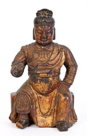 Chine, XVIIIe siècleStatue en bois sculpté, laqué et doré représentant Guandi assis.H: 23,5 cm