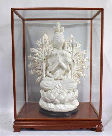 A Thousand Arm Blanc de Chine Guanyin, Cast Seated on a Lotus Throne Primary Hands in Namaste Mudra & Two in the Lap, 20th C.,