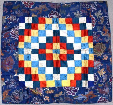 A Tibetan Buddhist Cloth, the Centre Squares of Fluttering Prayer Flags with Lotus Border, Lined with Red, 20th C.,