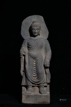 A STONE CARVED  STANDING BUDDHA STATUE