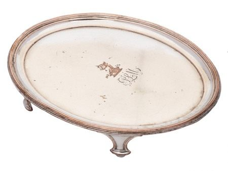 A 19th century Sheffield plate teapot stand: crested and initialled,