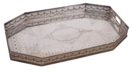 A late Victorian/ Edwardian silver plated serving tray: of rectangular outline with canted corners