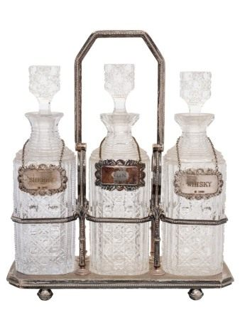 A Victorian silver plated three-division tantalus: inscribed,