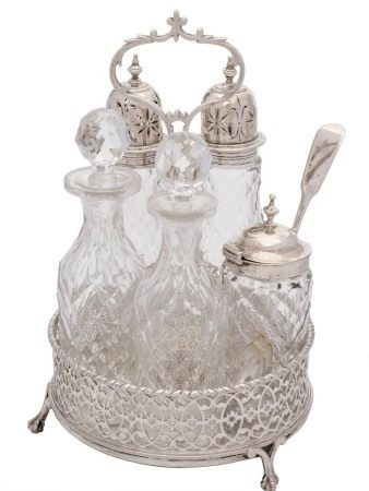 A 19th century silver circular five bottle cruet: the stand with indistinct maker's marks,