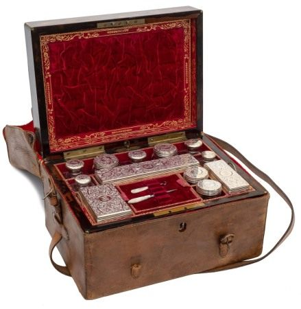 A Victorian coromandel and brass strung travelling toiletry box: the hinged lid enclosing a fitted