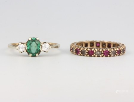A 9ct yellow gold gem set eternity ring size L, a ditto 3 stone ring size O, 4.5 grams