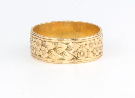 A 22ct yellow gold engraved wedding band, size L 1/2, 4.1 grams