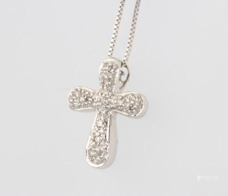 A 9ct white gold diamond set cross pendant on a 40cm chain, 2 grams