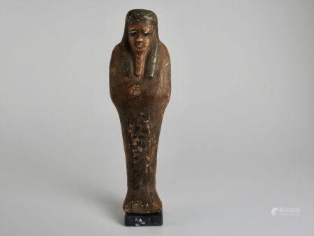 Oushebti.Terre cuite peinte ornée de registres.Type du Nouvel Empire.H :9,5cm.