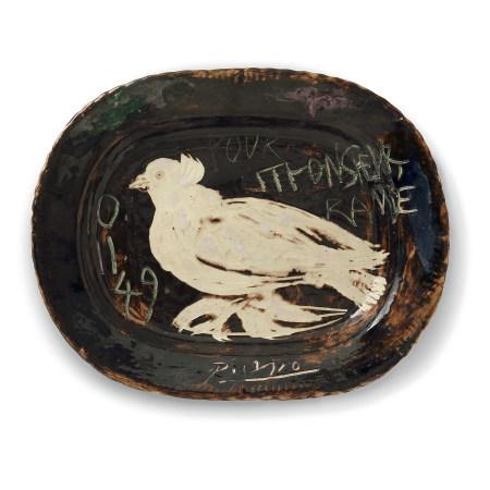 ¤ PABLO PICASSO (1881-1973)  PLAT 'COLOMBE', 1949  en faïence, décor i