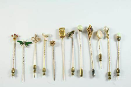 TWELVE ASSORTED STICK PINS including a green enamel, diamond and half pearl insect stick pin, a gold