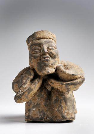 A PAINTED POTTERY FIGURE OF A SEATED DIGNITARY