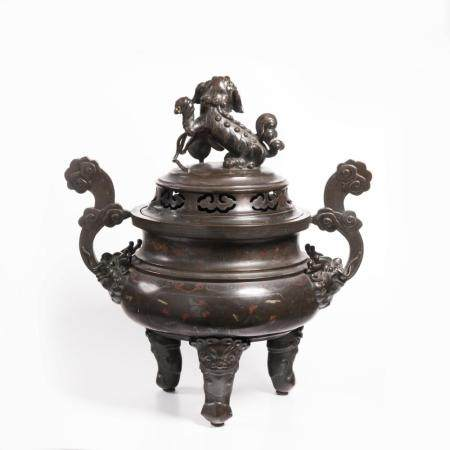 A LARGE BRONZE TRIPOD INCENSE BURNER WITH LION DOG FINIAL