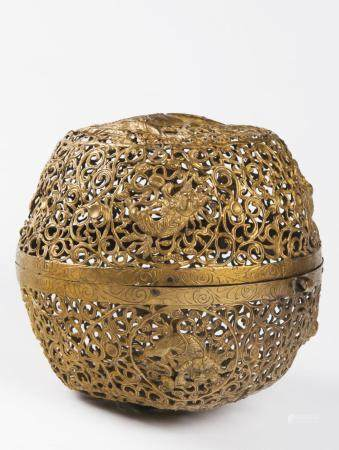 A PIERCED GILT BRASS INCENSE BALL