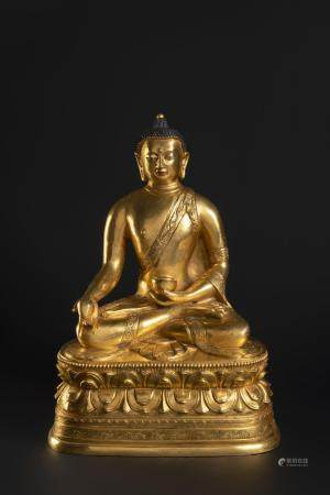 A GILT-BRONZE FIGURE OF THE MEDICINE BUDDHA