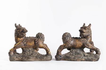 A PAIR OF GILT-DECORATED CAST-IRON BUDDHIST QI-LIN LIONS
