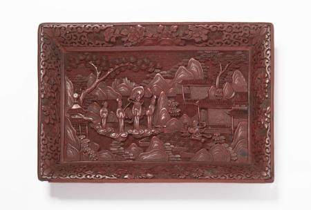 A CARVED CINNABAR LACQUER TRAY