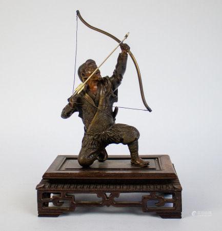 Bronze Japanese archer on wooden base