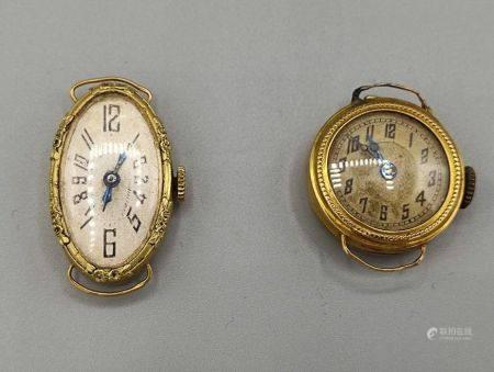 Deux cadrans de montres en or jaune 750°°. Poinçon tête d'aigle. Bosses PB: 16.3 g.