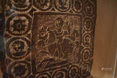 Square Coptic Textile Panel of A Man on Horse enclosed within a border of roundels.