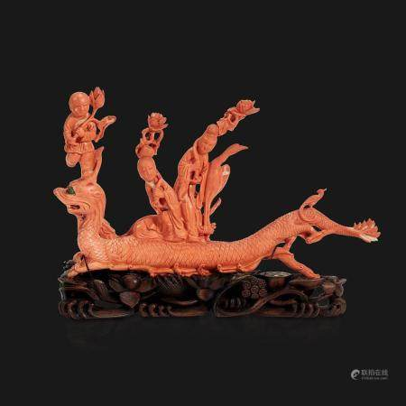 """A Chinese carved coral """"Dragon, Boy, and Meiren"""" group,"""