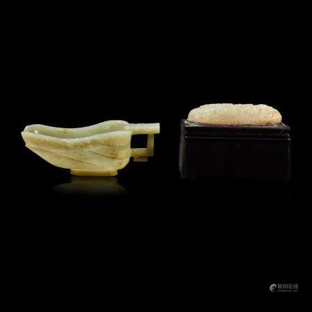 """A Chinese celadon jade libation cup, Yi, and a carved grey-white jade oval """"Dragon"""" plaque, the jades late Ming to Qing Dynasty"""