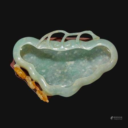 A Chinese carved pale greenish-white and russet jadeite brush washer,
