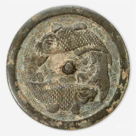 "A Chinese bronze ""Twin Carp"" circular mirror, Jin Dynasty (1115-1234)"