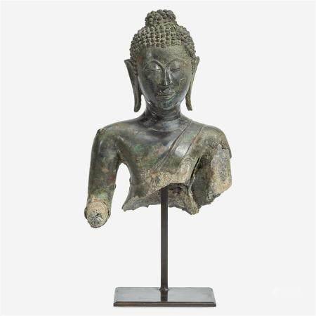 A Thai bronze head and torso of a Buddha, 15th Century