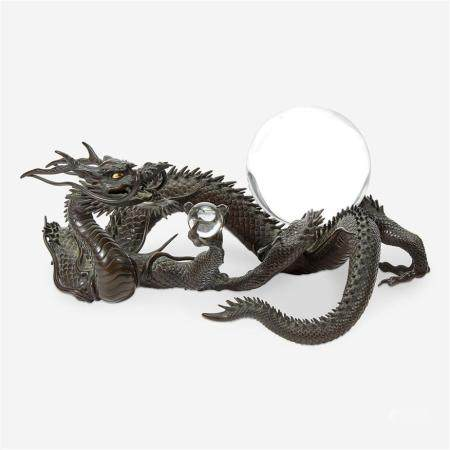 A Japanese patinated bronze dragon and rock crystal sphere, Meiji period